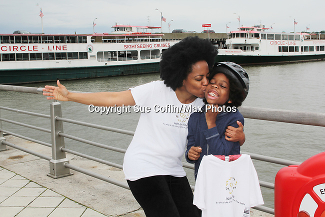 Another World's and singer Rhonda Ross and son Raif - she sang the National Anthem  - Hearts of Gold 7th Annual Run/Walk for Kids with proceeds from this fun family event will change the futures of homeless mothers and their children on June 3, 2017 at Pier 84 Hudson Parks, New York City, New York. It supports Hearts of Gold Annual Back to School Programs. (Photo by Sue Coflin/Max Photos)