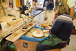 Woman pottery class lesson learning making pot in potters studio UK