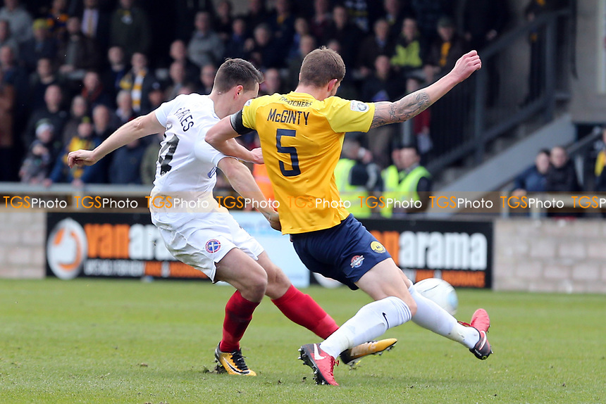 Sean McGinty of Torquay United and Daniel Sparkes of Dagenham  during Torquay United vs Dagenham & Redbridge, Vanarama National League Football at Plainmoor on 17th February 2018