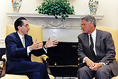 United States President Bill Clinton meets NATO Secretary General Willy Claes in the Oval Office of the White House in Washington, DC on October 2, 1995. The two discussed a range of NATO issues, including the NATO role in Bosnia and NATO enlargement. The President congratulated Claes on the key role that NATO has played in defending the safe areas in Bosnia and advancing the cause of peace. He stressed the importance of completing planning for implementation of a peace settlement in Bosnia. Claes briefed the President on the presentation of the NATO enlargement study to members of the Partnership for Peace on September 28. President Clinton welcomed the completion of the study and reiterated strong U.S. support for steady progress toward NATO enlargement and for the parallel development of a strong NATO-Russia partnership. Secretary General Claes also met with National Security Advisor Anthony Lake during his visit to the White House.<br /> Mandatory Credit: Ralph Alswang / White House via CNP