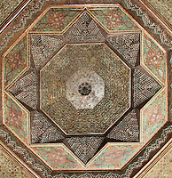 Ceiling of the reception room in carved and painted cedar wood, Kasbah of the Glaoua family, Telouet, High Atlas, Morocco. The fortress was begun in the 19th century as the residence Thami el Glaoui, 1879-1956, who was Pasha of Marrakech 1912-56. It sits at 1800m in the Atlas mountains on an ancient caravan route from the Sahara to Marrakech. Picture by Manuel Cohen