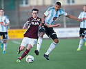 Stenny's Kris Faulds and Hearts Osman Sow challenge for the ball.