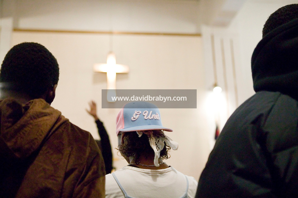 New York, USA - Teenagers attend at the Greater Hood Memorial AME Zion Church, home of the Hip-Hop Church, in Harlem, New York, USA, 17 February 2005. Photo Credit: David Brabyn.