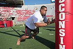 Wisconsin Badgers defensive lineman Olive Sagapolu (99) warms up prior to an NCAA College Football game against the Florida Atlantic Owls Saturday, September 9, 2017, in Madison, Wis. The Badgers won 31-14. (Photo by David Stluka)