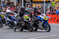 Toby Summer collides with David Hall in Formula 2 600cc race two. The 2018 Suzuki series Cemetery Circuit motorcycle racing at Cooks Gardens in Wanganui, New Zealand on Wednesday, 28 December 2018. Photo: Dave Lintott / lintottphoto.co.nz