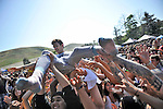 Grouplove drummer Ryan Rabin surfs the crowd at the end of the group's performance at the KROQ Weenie Roast y Fiesta Saturday in Irvine.