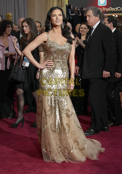 Catherine Zeta-Jones (wearing Zuhair Murad).2013 Vanity Fair Oscar Party following the 85th Academy Awards held at the Sunset Tower Hotel, West Hollywood, California, USA..February 24th, 2013.oscars full length gold sequins sequined dress hand on hip metallic sheer tulle .CAP/ADM/RE.©Russ Elliot/AdMedia/Capital Pictures.