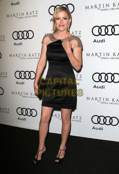 Kathleen Robertson.Audi And Martin Katz Kick Off Golden Globes Week 2012 Held At Cecconi's Restaurant, West Hollywood, California, USA..January 8th, 2012.full length dress black hand arm clutch bag sleeves sheer gold .CAP/ADM/KB.©Kevan Brooks/AdMedia/Capital Pictures.