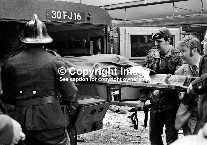 Explosion in Donegall Street, Belfast, in which 7 people died and 130 were injured. Four of the dead were bin men. No warning bomb was in a car. One of injured is taken away in a British Army ambulance. NI Troubles. Linenhall, Ref: 19720320001...Copyright Image from Victor Patterson, 54 Dorchester Park, Belfast, UK, BT9 6RJ..Tel: +44 28 9066 1296.Mob: +44 7802 353836.Voicemail +44 20 8816 7153.Skype: victorpattersonbelfast.Email: victorpatterson@mac.com.Email: victorpatterson@ireland.com (back-up)..IMPORTANT: If you wish to use this image or any other of my images please go to www.victorpatterson.com and click on the Terms & Conditions. Then contact me by email or phone with the reference number(s) of the image(s) concerned.