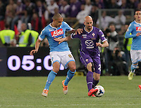 Gokhan Inler  Borja Valero   during the the Italian Cup final soccer match between Napoli and  Fiorentina at the Olympic stadium in Rome May 3, 2014