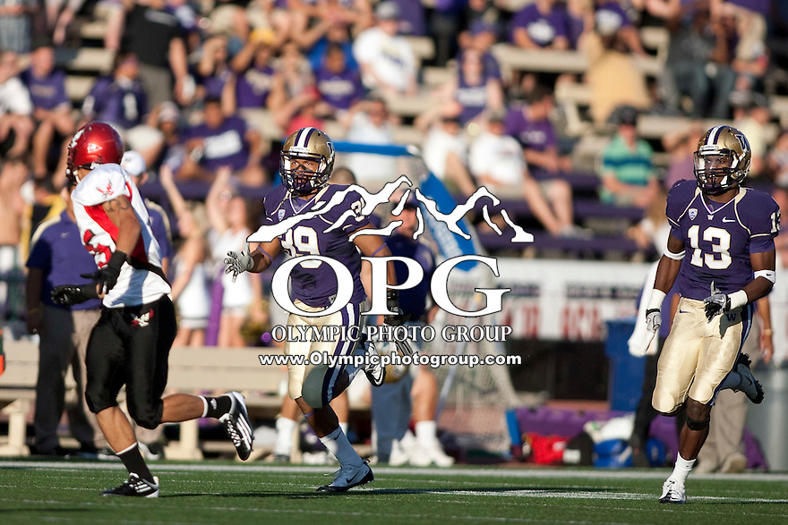 Sept 3, 2011:  Washington special team players   (right) Will Shamburger and (left) Greg Walker against Eastern Washington.  Washington defeated Eastern Washington 30-27 at Husky Stadium in Seattle, Washington....