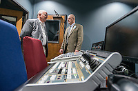 STAFF PHOTO ANTHONY REYES &bull; @NWATONYR<br /> John La Tour, left, incoming Fayetteville alderman, talks with Fritz Gisler, director of media services, Monday Dec. 29, 2014 in the control room of the Fayetteville Television Center during a tour of the center in Fayetteville. La Tour was touring several city owned sites to learn more of what the city offers to citizens including Water &amp; Sewer offices, Fayetteville Animal Shelter, Transportation and Fleet divisions among other sites and offices.