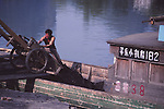 China, a boat loaded with coal in the Li River, Guangxi Zhuang Autonomous Region