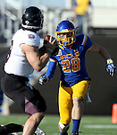 BROOKINGS, SD - NOVEMBER 5:  Chris Balster #28 from South Dakota State eyes quarterback Brodie Lambert #9 form Missouri State in the first half Saturday afternoon at Dana J. Dykhouse Stadium in Brookings. (Photo by Dave Eggen/Inertia)