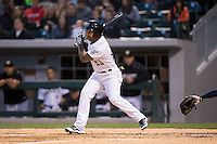 Leury Garcia (24) of the Charlotte Knights follows through on his swing against the Scranton\Wilkes-Barre RailRiders at BB&T BallPark on May 1, 2015 in Charlotte, North Carolina.  The RailRiders defeated the Knights 5-4.  (Brian Westerholt/Four Seam Images)