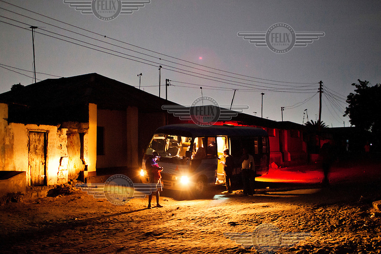 Ramson, a peer educator and former drug user, and the MDM (Medecins du Monde) bus during a night shift in Dar es Salaam.