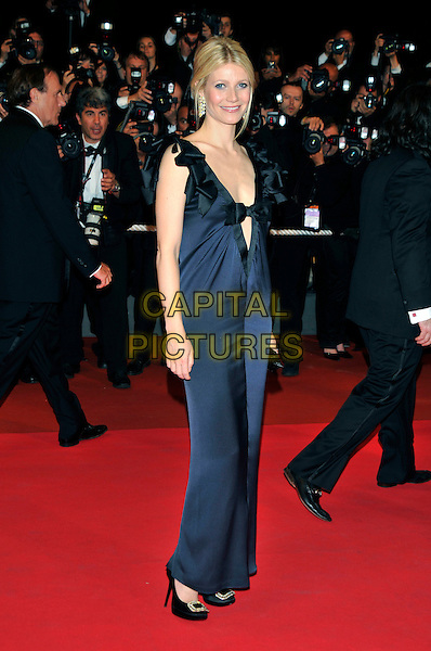 "GWYNETH PALTROW .""Two Lovers"" arrivals at Palais de Festival during the 61st Cannes International  Film Festival,.France, 19th May 2008 .red carpet full length navy blue bow ruffle shoulders low cut dress heels buckle shoes plunging neckline .CAP/PL.© Phil Loftus/Capital Pictures"