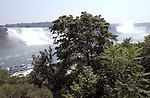 Niagara Falls, Ontario, Canada - 01 August 2006---A boat cruising Niagara River with the Horseshoe Falls (ri), on the Canadian side and the American Falls (le), on the United States' side---nature, landscape, transport---Photo: © HorstWagner.eu