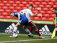 Sheffield United v Gillingham .Sky Bet League 1 ....... uniteds paul coutts with gillinghams jake hessenthaler