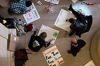 People make protest signs in Lobby 7 in MIT's Building 7 in Cambridge, Massachusetts, before the March for Science demonstration on Sat., April 22, 2017.