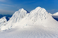 Spring landscape aerial view of snow-covered Chugach Mountain peak sticking up above glacier and ice field  in southcentral Alaska  <br /> <br /> (C) Jeff Schultz/SchultzPhoto.com  ALL RIGHTS RESERVED