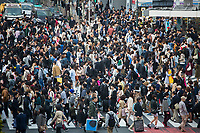 Pedestrians cross the Shibuya crossing, reportedly the busiest in the work, in central Tokyo.