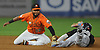 Elmer Reyes #13, Long Island Ducks second baseman, left, tags out Jared Mitchell #10 of York Revolution in the top of the first inning in Game 1 of the Atlantic League Championship Series at Bethpage Ballpark in Central Islip, NY on Wednesday, Sept. 27, 2017.