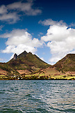 MAURITIUS, Trou D'eau Deuce, sailing in the Indian Ocean off the East coast of Mauritius with the 4 Sisters Mountains in the background