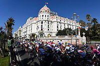 14th March 2020, Paris to Nice cycling tour, final day, stage 7;   illustration picture of the peleton riding past Le Negresco Hotel during stage 7 of the 78th edition of the Paris - Nice cycling race, a stage of 166,5km with start in Nice and finish in Valdeblore La Colmiane on March 14, 2020 in Valdeblore La Colmiane, France