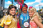 Three teenage acting school students posing in fanyc costumes - teen boy in Arabian Prince, white Girl in yellow gown, girl dressed as Barbie doll- from Merrick Theatre & Center for the Arts, at Merrick Street Fair, on October 22, 2011, Merrick, New York, USA. Editorial