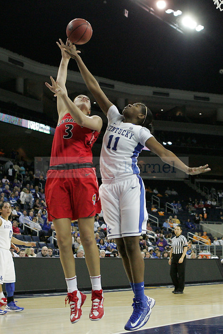 UK center DeNesha Stallworth attempts to block a shot by UGA forward Anne Marie Armstrong during the second half of the University of Kentucky women's basketball game vs. University of Georgia during the SEC tournament The Arena at Gwinnett Center in Duluth, Ga. on Saturday, March 9, 2013. UK won 68-30. Photo by Genevieve Adams | Staff