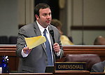 Nevada Assemblyman James Orhrenschall, D-Las Vegas, works on the Assembly floor at the Legislative Building in Carson City, Nev., on Friday, May 24, 2013. <br /> Photo by Cathleen Allison