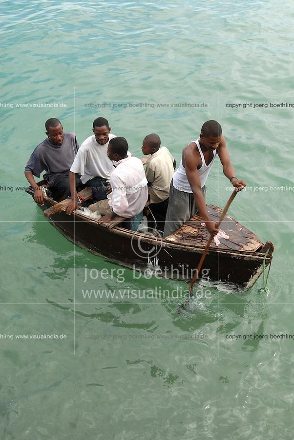 Tanzania, Zanzibar, people in small wooden boat / Tansania, Sansibar, Menschen in einem kleinen Holzboot