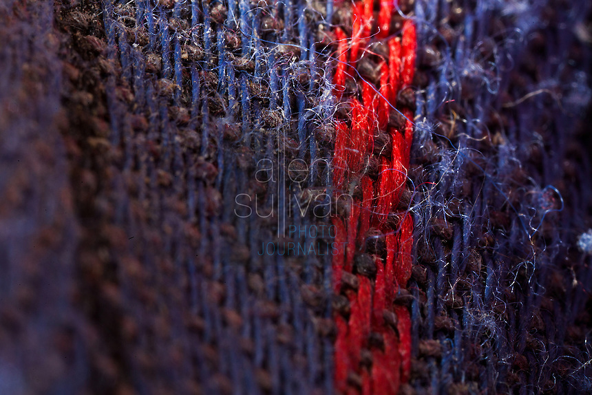 Macro image of work glove threads.