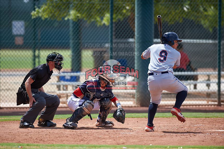 AZL Indians Red Jothson Flores (9) at bat in front of home plate umpire Bailey Dutten and catcher Michael Amditis (8) during an Arizona League game against the AZL Indians Red on July 7, 2019 at the Cleveland Indians Spring Training Complex in Goodyear, Arizona. The AZL Indians Blue defeated the AZL Indians Red 5-4. (Zachary Lucy/Four Seam Images)