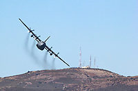 Missouri Air National Guard C-130H2 from the 139th Air Wing based Rosecrans Air National Guard Base in St. Joseph makes a turn over the Marin Headlands north of San Francisco