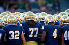 Sept. 5, 2015; The Football team huddles before the game against Texas. Notre Dame won 38-3. (Photo by Matt Cashore)
