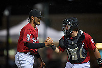 Billings Mustangs relief pitcher Jeffry Nino (45) celebrates with Valentin Martinez (46) after a Pioneer League game against the Grand Junction Rockies at Dehler Park on August 15, 2019 in Billings, Montana. Billings defeated Grand Junction 11-2. (Zachary Lucy/Four Seam Images)