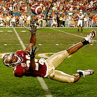 KEEPING YOUR EYES ON THE BALL:  Despite being upended by a Penn State defensive back, Florida State's Willie Reid, still suspended in mid-air, attempts to haul in a Drew Weatherford pass in the first quarter of the 2006 Fed Ex Orange Bowl.  Reid, who caught four passes for 55 yards and set an Orange Bowl record with an 87-yard punt return for a touchdown that kept Florida State in the game, was named Orange Bowl MVP.