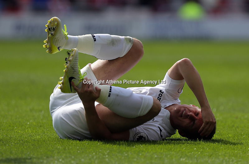 SUNDERLAND, ENGLAND - MAY 13: Tom Carroll of Swansea City rolls on the ground after being tackled during the Premier League match between Sunderland and Swansea City at the Stadium of Light, Sunderland, England, UK. Saturday 13 May 2017