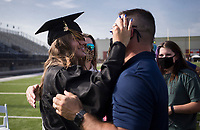 Graduate Abi Sobiech comforts her dad as John Sobiech after receiving her diploma, Friday, July 17, 2020 during a graduation ceremony at Bentonville High School in Bentonville. Check out nwaonline.com/200718Daily/ for today's photo gallery. <br /> (NWA Democrat-Gazette/Charlie Kaijo)