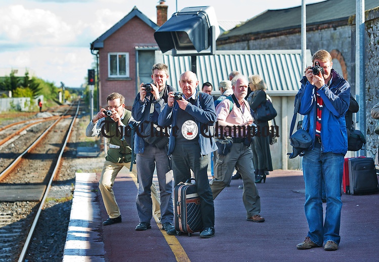 Train enthusiasts gather on the platform in Ennis Station to photograph the arrival of a steam engine on the Railway Preservation Society Of Ireland South Clare Railtour. Photograph by John Kelly.
