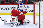 20 December 2014: Carolina's Cam Ward (30) is beaten by New York's Kevin Klein (not pictured) for the tying goal late in the third period as New York's Martin St. Louis (26) watches. The Carolina Hurricanes played the New York Rangers at the PNC Arena in Raleigh, North Carolina in a 2014-15 National Hockey League game. Rangers won the game 3-2 after winning the shoot out 1-0 after overtime.