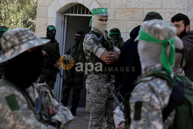 Palestinian members of the Ezzedine al-Qassam Brigades, the armed wing of the Hamas movement mourn during the funeral of fellow militant Ahmed al-Zahar in the village of Al-Moghraga near the Nuseirat refugee camp in the central Gaza Strip on February 3, 2016. The collapse of a tunnel in the Gaza Strip has killed two militants from Hamas's armed wing, officials said Wednesday, as concern grows in Israel over the rebuilding of tunnels that can be used for attacks. Photo by Mohammed Asad