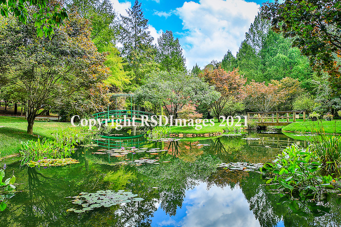 """Gibbs Garden is called Georgia's """"hidden jewel"""", this magnificent 300-acre estate features more than 220 acres of gardens set in a mature hardwood forest with 30 spring-fed ponds, waterfalls and bridge crossings. Set in the rolling woodlands of north Cherokee County, Gibbs Gardens offers you a garden"""