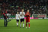 Manuel Neuer, Per Mertesacker und Miroslav Klose (D) auf der Ehrenrunde