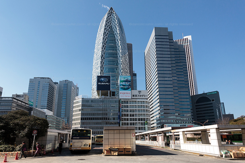 Homeless shelters made from cardboard boxes  in a bus station in Shinjuku with the Cocoon Twoer and other skyscrapers behind. Shinjuku, Tokyo, Japan. Friday January 15th 2016