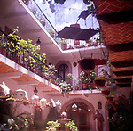 A294HD Caged birds in open air hotel courtyard Mexico