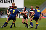 Blair Feeney goes for the gap between Nigel Hall & Nick Evans.  Air NZ Cup game between Counties Manukau & Otago played at Mt Smart Stadium,Auckland on the 29th of July 2006. Otago won 23 - 19.