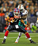 7 December 2008: Buffalo Bills' quarterback J.P. Losman is tackled by Miami Dolphins' linebacker Joey Porter during the first regular season NFL game ever to be played in Canada. The Dolphins defeated the Bills 16-3 at the Rogers Centre in Toronto, Ontario. ..Mandatory Photo Credit: Ed Wolfstein Photo